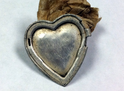 back of the silver locket piece