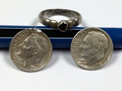 Two silver dimes and a silver ring