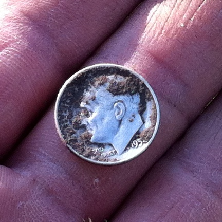 1954 U.S. dime with dirt on it