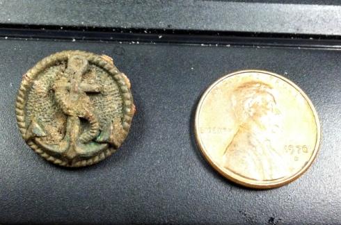 brass button and Linconl cent