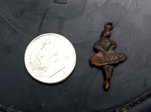 small pendant in shape of ballerina