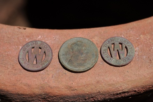 1917 Lincoln cent and two transportation tokens