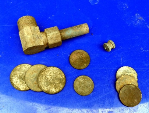 various modern coins and a home-made pot pipe