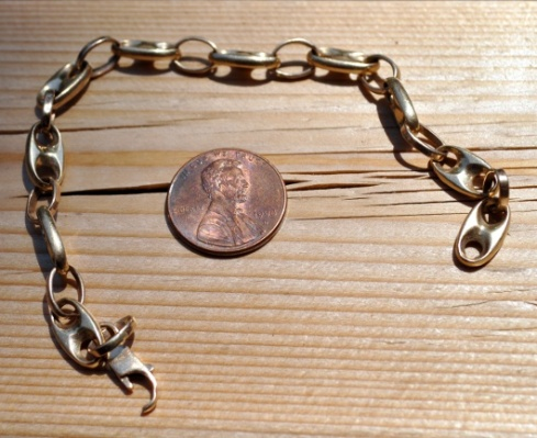 gold bracelet and Lincoln cent