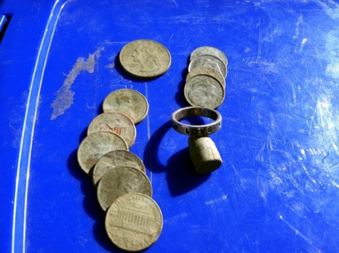 coins, bullet, and silver ring